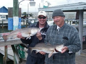 Ted and Charlie display their Tampa Bay Redfish